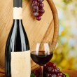 Composition of wine, wooden barrel and grape, on bright background — Stock Photo #35994267