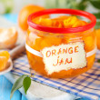 Stock Photo: Orange jam with zest and tangerines, on blue wooden table