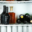 Refrigerator full of bottles with alcoholic drinks — Stock Photo #35995681