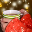Hands holding mug of hot drink, close-up, on bright background — Stock Photo #35996723