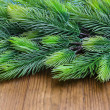 Christmas fir tree on wooden background — Stock Photo
