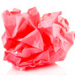 Stock Photo: Pink crumpled paper ball isolated on white