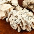 Stock Photo: Crumpled paper balls on wooden background