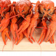 Tasty boiled crayfishes on chopping board close-up — Stock Photo