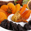 Dried fruits with anise stars on plate close-up — Stock Photo