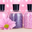 Aromatherapy minerals - colorful bath salt on pink background — Photo
