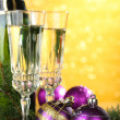 Composition with Christmas decorations and two champagne glasses, on bright background — ストック写真