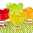 Tasty jelly cubes in bowls on table on white background — ストック写真