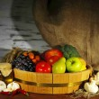 Composition of different fruit and vegetables on table on sackcloth background — Stock Photo
