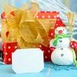 Beautiful Christmas composition with gift and Christmas toys close-up — Stock Photo