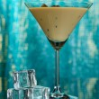 Baileys liqueur in glass on blue background — Stock Photo