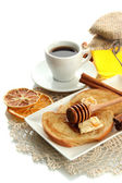 White bread toast with honey and cup of coffee, isolated on white — Stock Photo