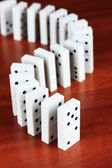 Dominoes on wooden background — Stock Photo