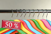 Wooden clothes hangers as sale symbol on gray background — 图库照片