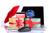 Laptop, gift and computer mouse isolated on white — Stock Photo