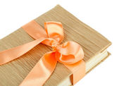 Book wrapped with color ribbon, isolated on white — ストック写真