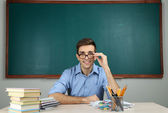 Young teacher sitting in school classroom — Stock Photo