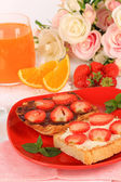 Delicious toast with strawberry on plate close-up — Stock Photo