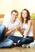Young couple celebrating moving to new home — 图库照片