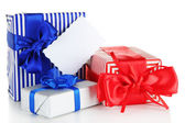 Gift boxes with blank label isolated on white — Stock Photo