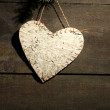 Decorative heart on rope, on wooden background — Stock Photo #36001973