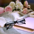 Composition with old book, eye glasses, candles and plaid on dark background — Stock Photo #36000019