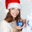 Stock Photo: Beautiful smiling girl near Christmas tree with ball