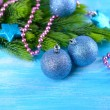 Christmas balls on fir tree, on color background — Stock Photo #36000897