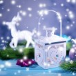 Christmas lantern, fir tree and decorations on light background — Stock Photo #36000907