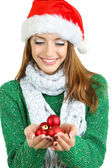 Beautiful smiling girl with Christmas toys isolated on white — Foto de Stock