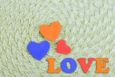 Hearts made of felt on green background — Stok fotoğraf