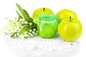 Decorative candle in form of apple jam with flowers isolated on white — Stock Photo
