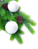 Christmas balls and snowflake on fir tree, isolated on white — Photo