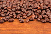 Sunflower grains in chocolate, on brown wooden background — Stock Photo
