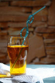 Glass of cocktail, on stone wall background — Stock Photo