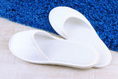 White slippers on floor background — Stock Photo