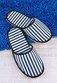 Striped slippers on floor background — ストック写真