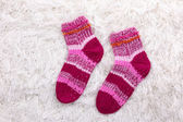 Woolen socks, on color background — Stock Photo
