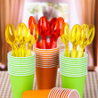 Stock Photo: Cups, spoons and forks, of different colors on bright background