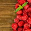 Fresh raspberry on wooden background — Stock Photo #36118555
