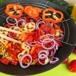 Vegetables in wok on wooden table close-up — Stock Photo