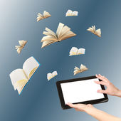 Tablet and opened books on blue background — Stock Photo
