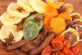 Dried fruits with anise stars on wooden background — Stock Photo