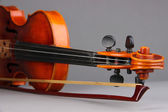 Classical violin on grey background — Stock Photo