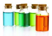 Bottles with basics oils isolated on white — Stock Photo