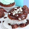 Stock Photo: Tasty cupcakes with gifts close up