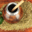 Stock Photo: Calabash and bombillwith yerbmate on wooden background