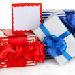 Gift boxes with blank label isolated on white — Photo