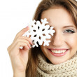 Beautiful smiling girl with Christmas snowflake isolated on white — Lizenzfreies Foto