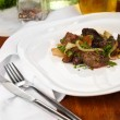 Stock Photo: Fried chicken livers on plate on wooden table close-up